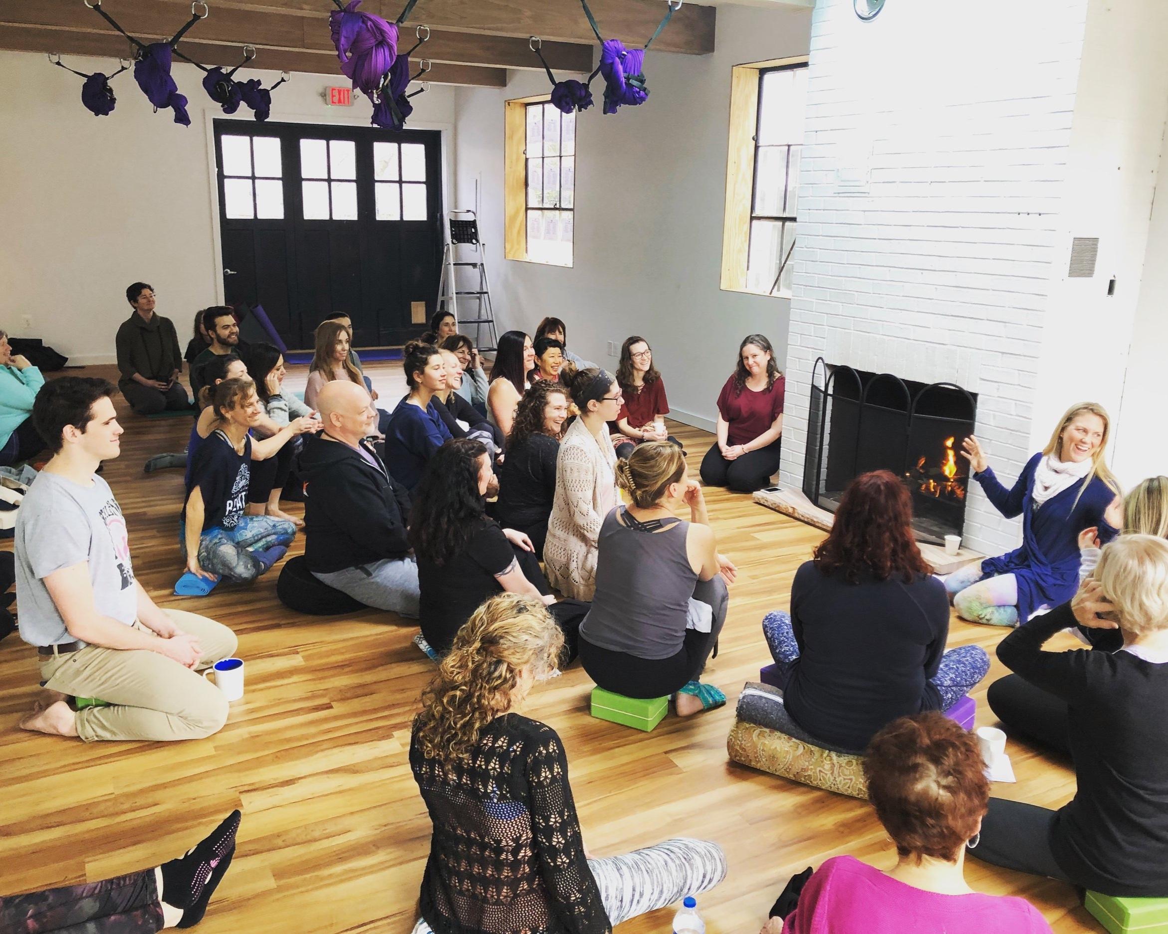 """Teacher meeting in 'The Garage"""" studio space."""