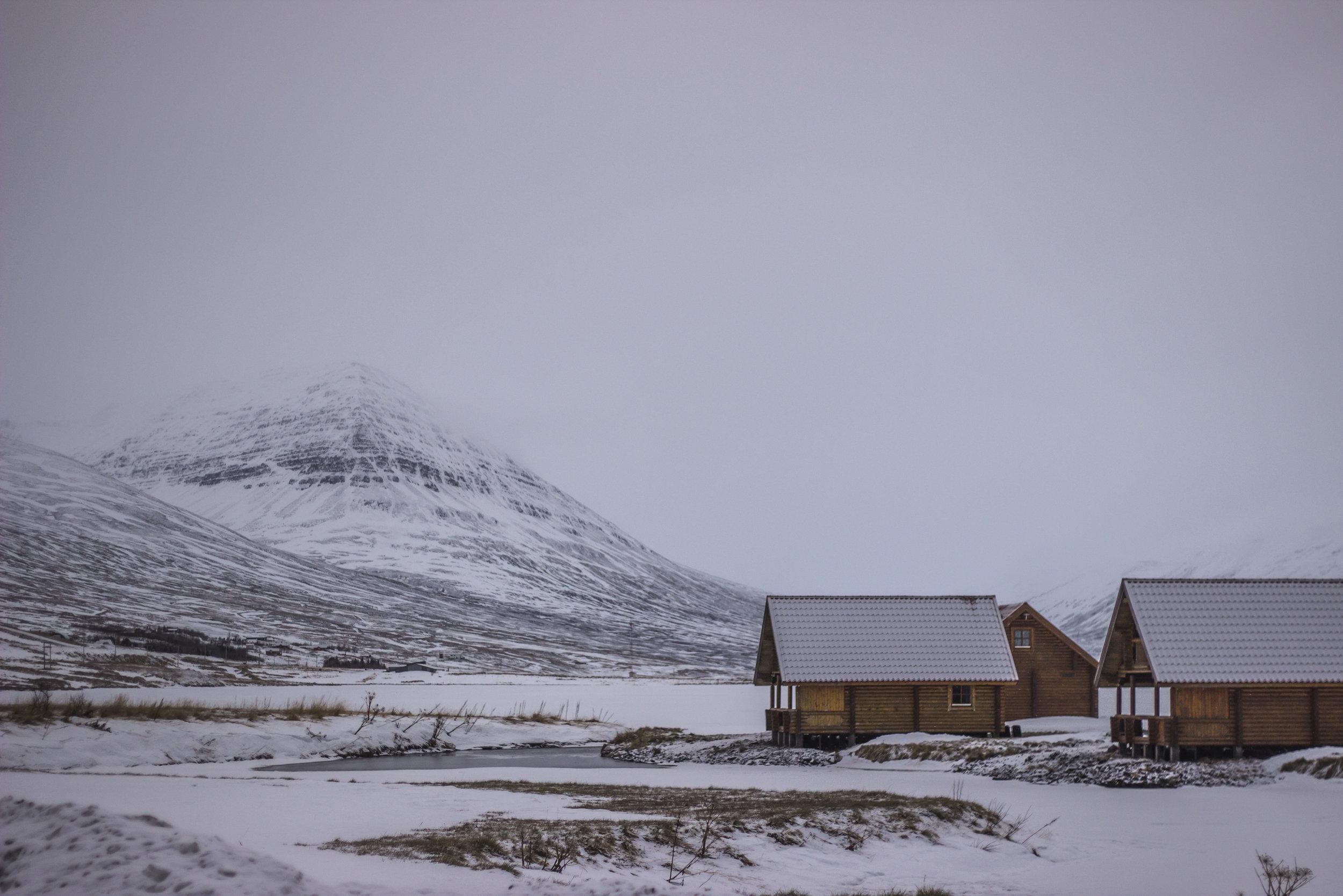 Summer cabins along Ólafsfjörður's frozen lake