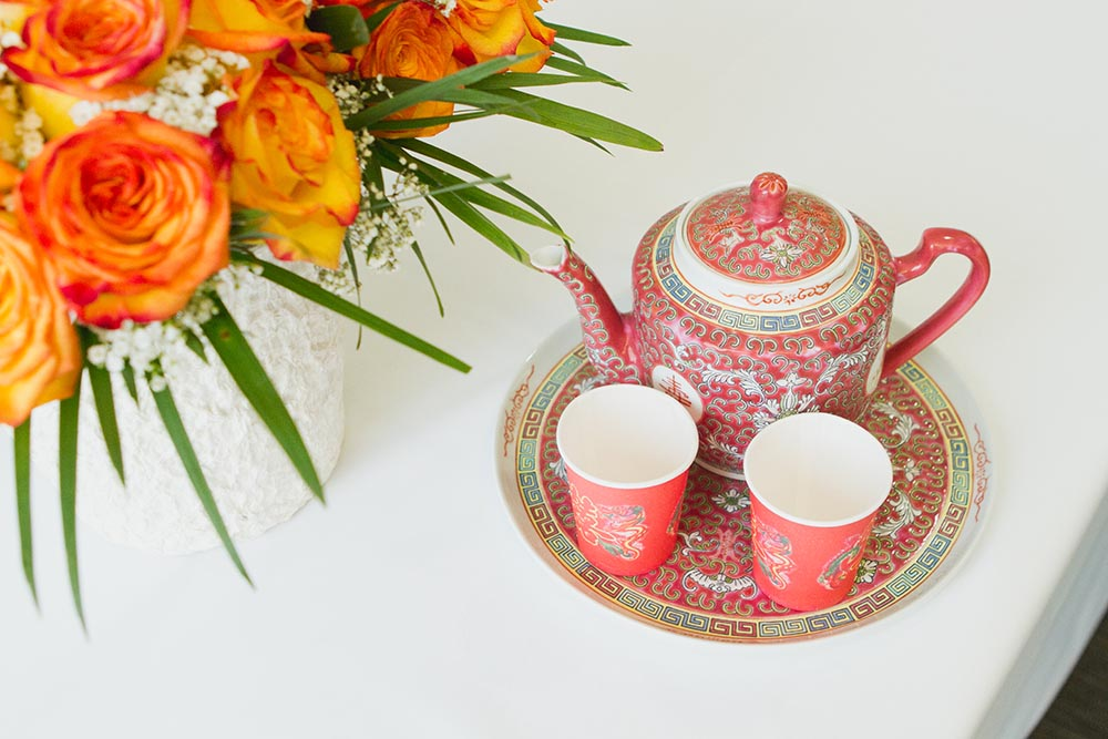 The couple honored Matt's Chinese heritage with a traditional tea ceremony -- and Edythe changed dresses to a traditional Chinese wedding dress!