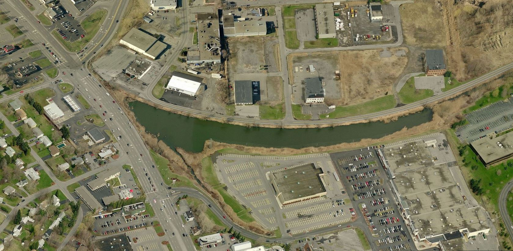 Aerial photograph of the Widewaters Pond (along Towpath Road).Imagine this remnant as the catalyst that helps close the gap in the Canalway Trail! The creation of a well-connected civic space at this site could offer tremendous value to residents, business owners, taxpayers, and visitors alike.
