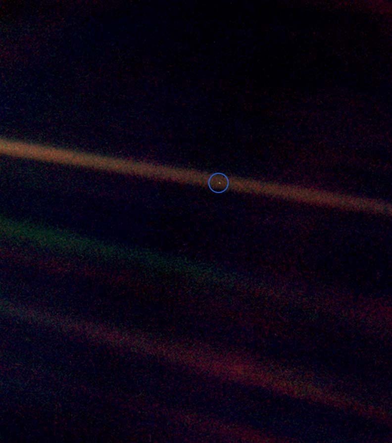 Pale Blue Dot, a photograph of planet  Earth taken on February 14, 1990, by the  Voyager 1  space probe from a record distance of about 6 billion kilometers (3.7 billionmiles, 40.5  AU ), as part of the  Family Portrait series of images of the  Solar System .