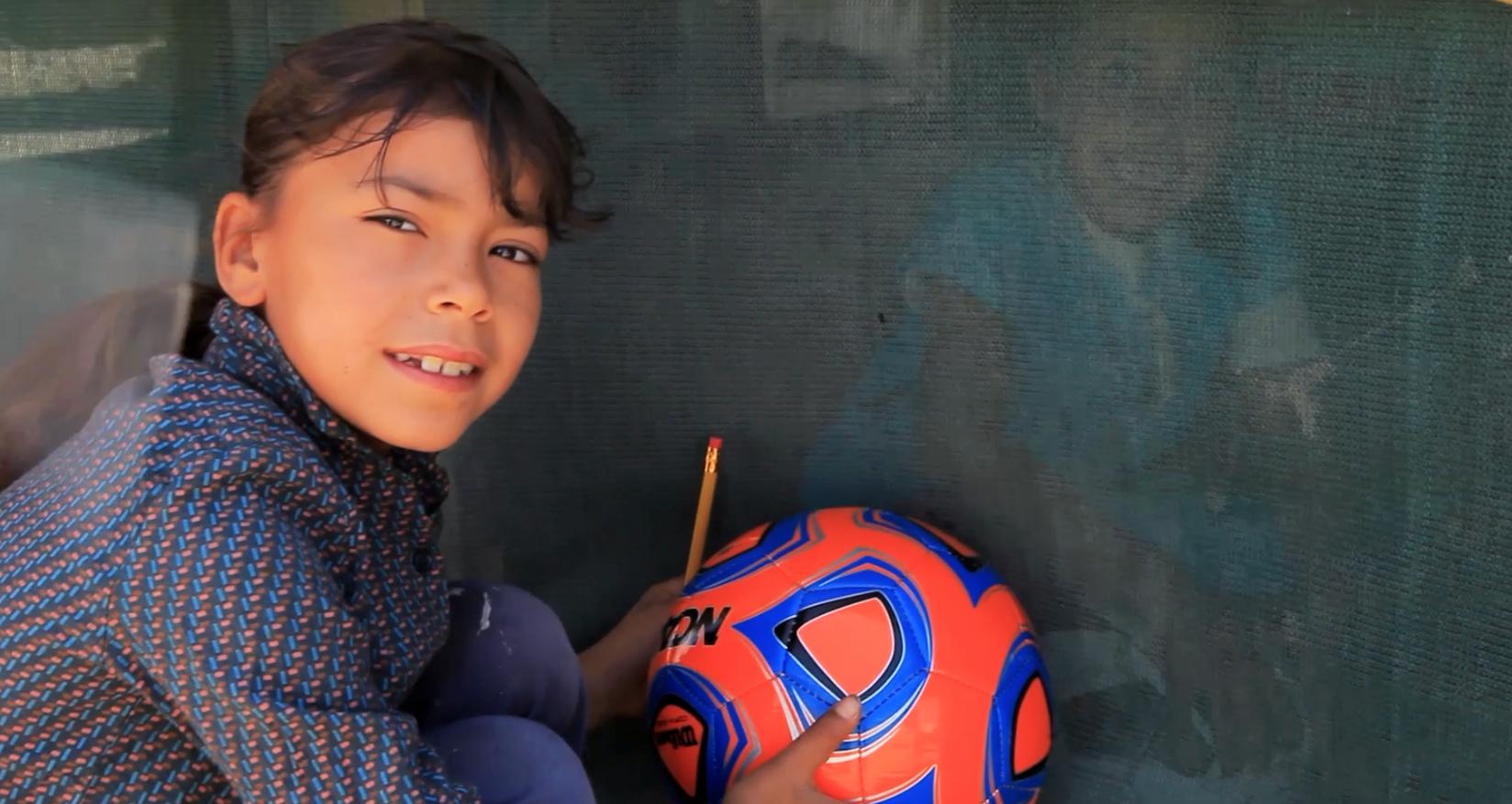 Blue orange soccer ball CU.png
