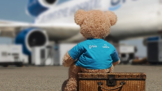 The ORBIS teddy bear stays behind with the young patient!