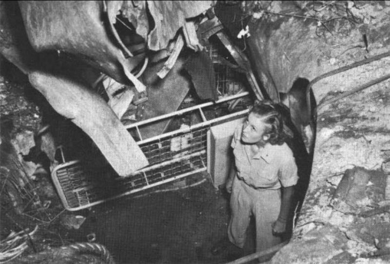 A nurse surveying kamikaze damage in April 1945.
