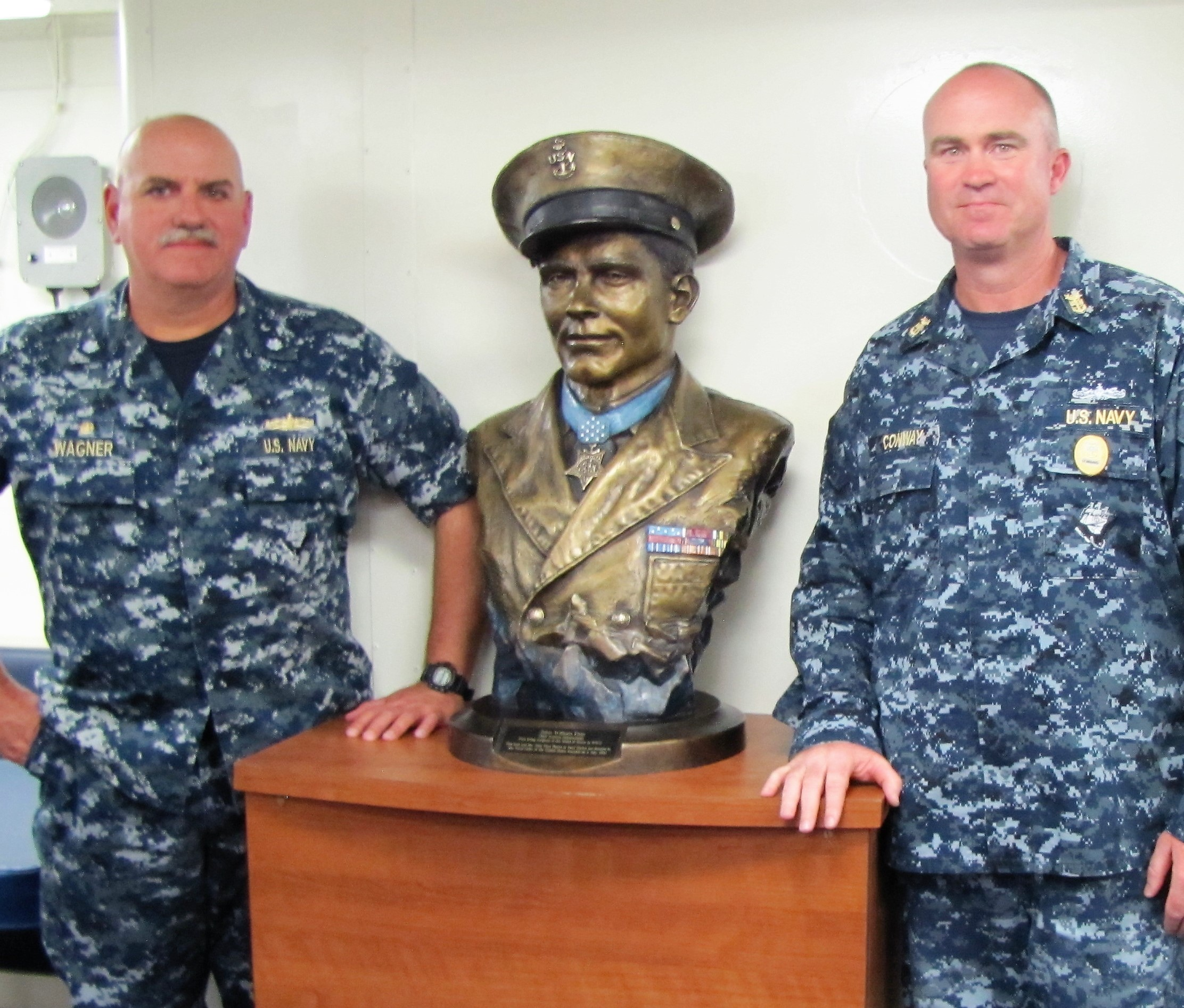 CO CDR Michael Wagner, left of Bust; Command Master Chief Thomas Conway, right of bust