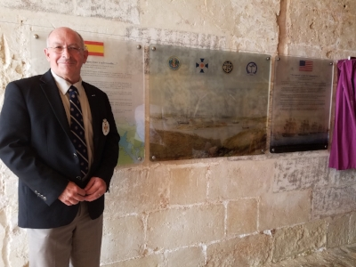 Captain John Rodgaard (USN Ret.) in front of the historic marker on the interior wall of the Royal Navy Hospital Museum, on the Isla del Rey in Port Mahon, the island of Menorca, Spain.