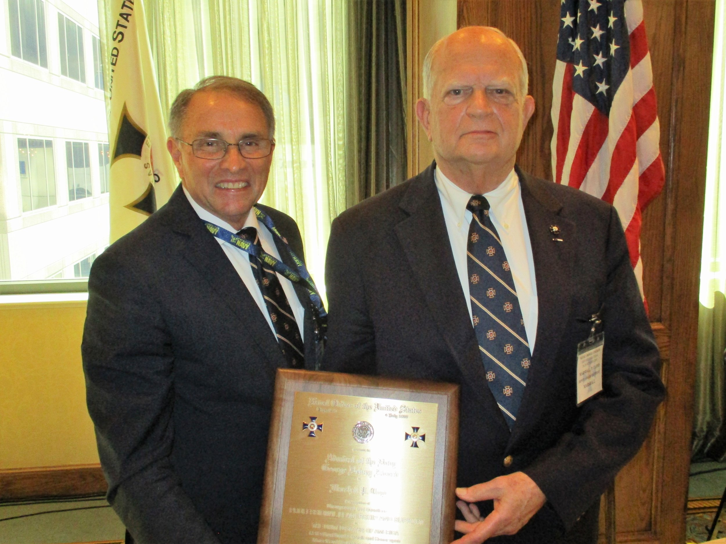 Mr. Marshall P. Cloyd (right) was awarded the Admiral of the Navy George Dewey Award by CAPT Paul Crissy, USCG (Ret.)