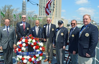 Naval Order Companions with wreath aboard the USS  Olympia.
