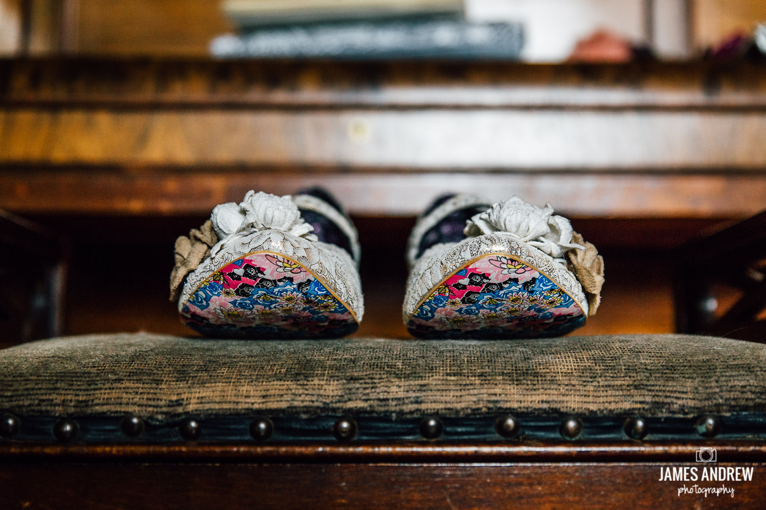 Alternative wedding shoes on bench colourful soles