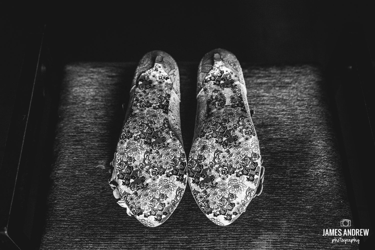 black and white picture of wedding shoes