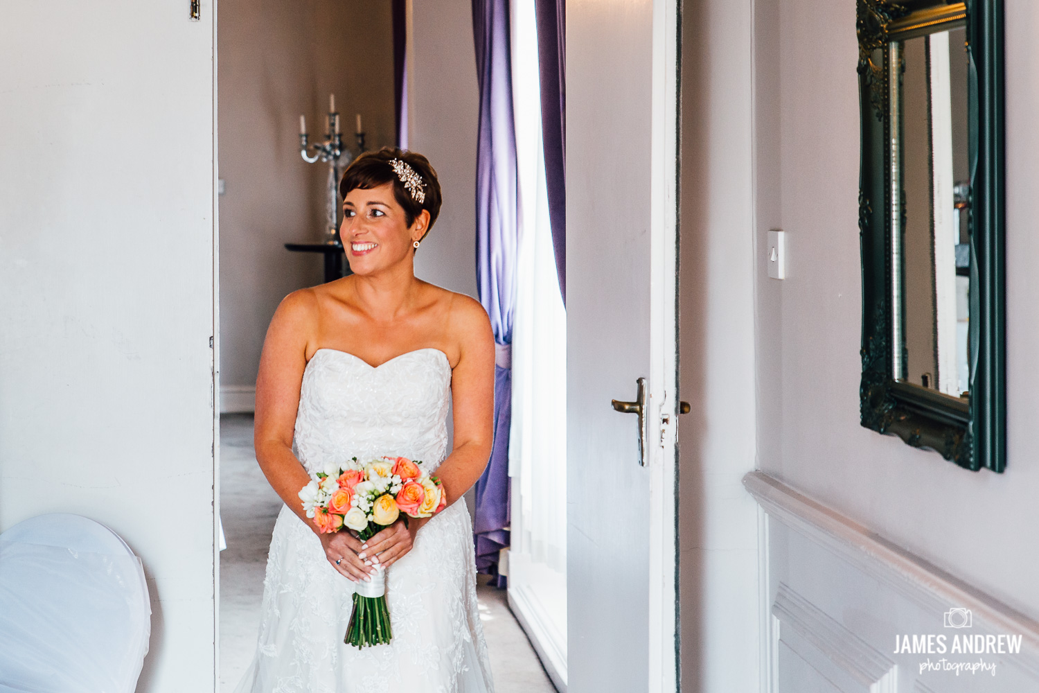 bride holding flowers walking in to ceremony room