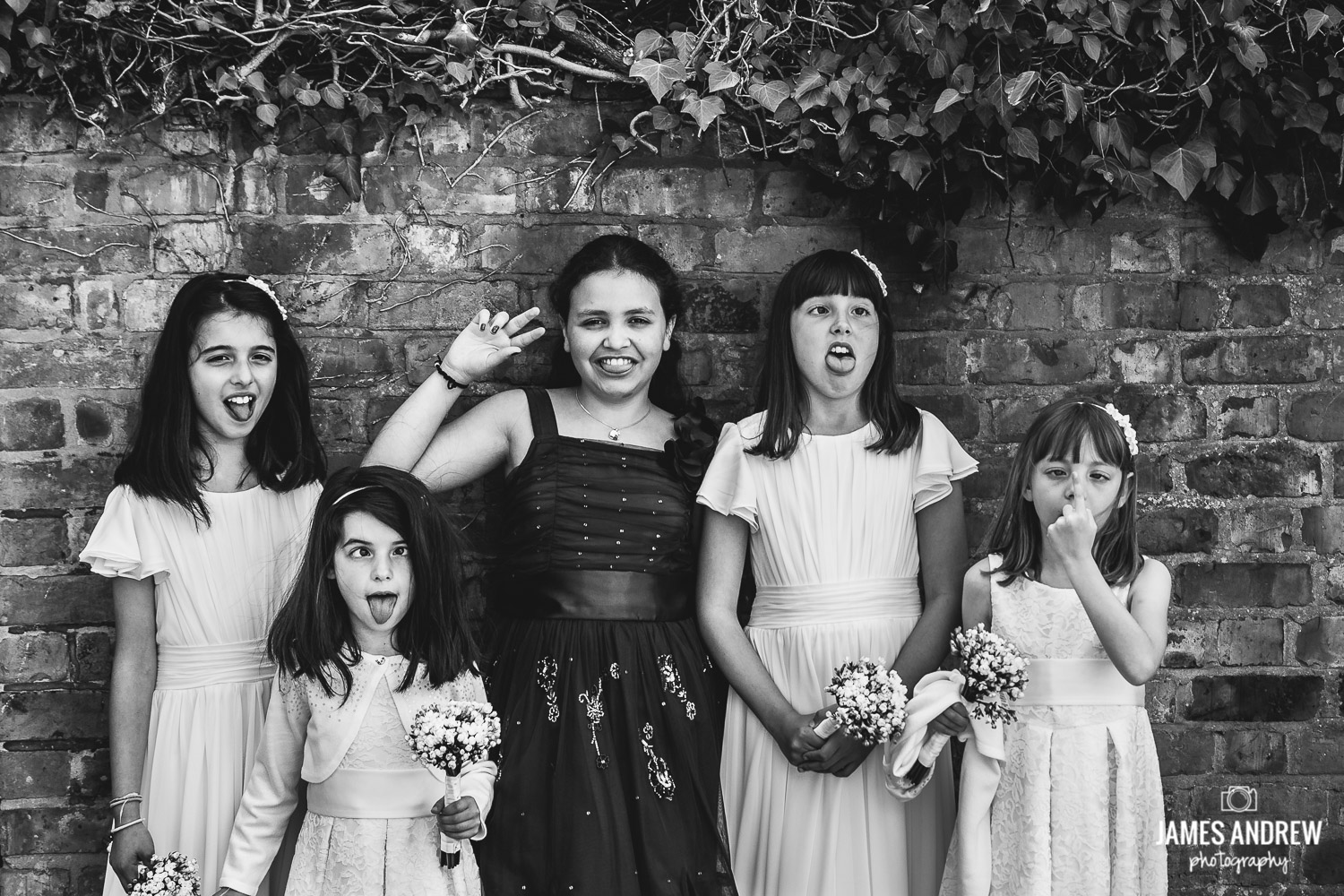 children at wedding having fun
