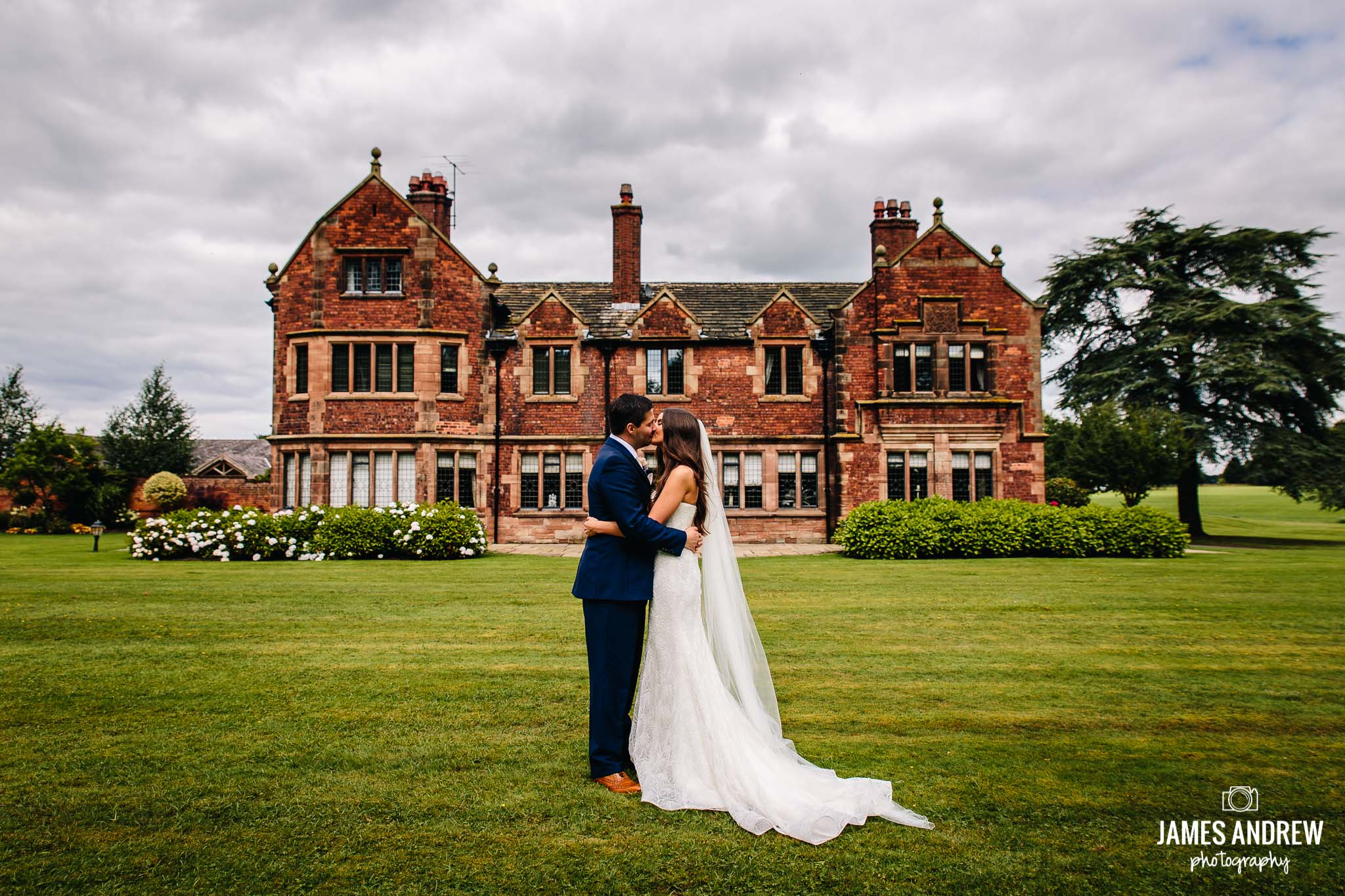 Colshaw Hall Bride And Groom Portrait in front of statley home manor house