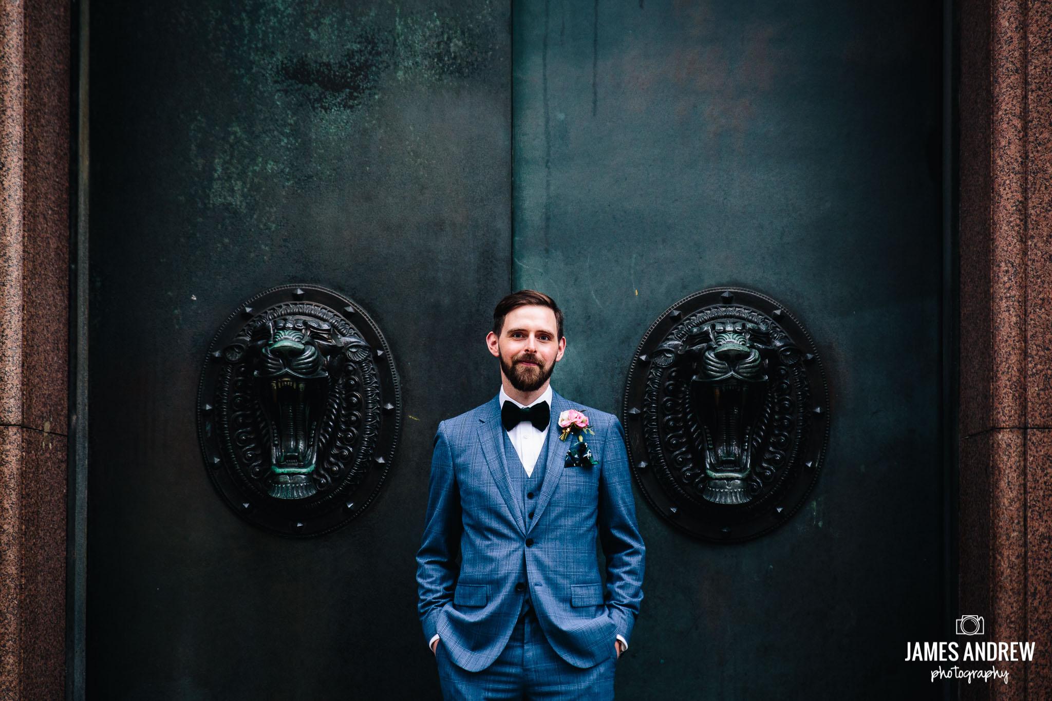 Edgy alternative Groom Portrait Infront Of Door Liverpool City wedding