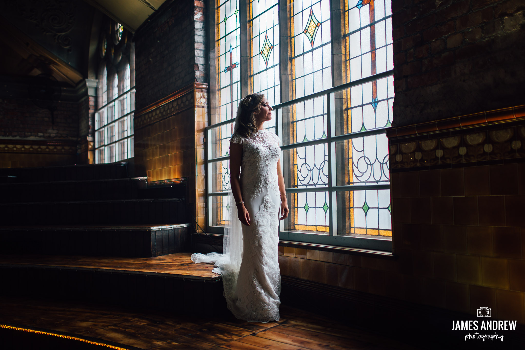 bride image looking out of window urban wedding style machester