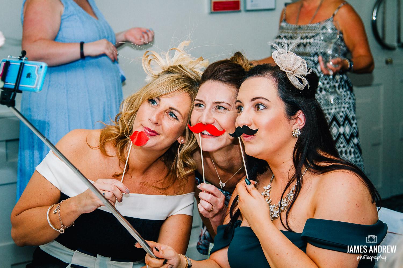 Girls taking wedding selfie