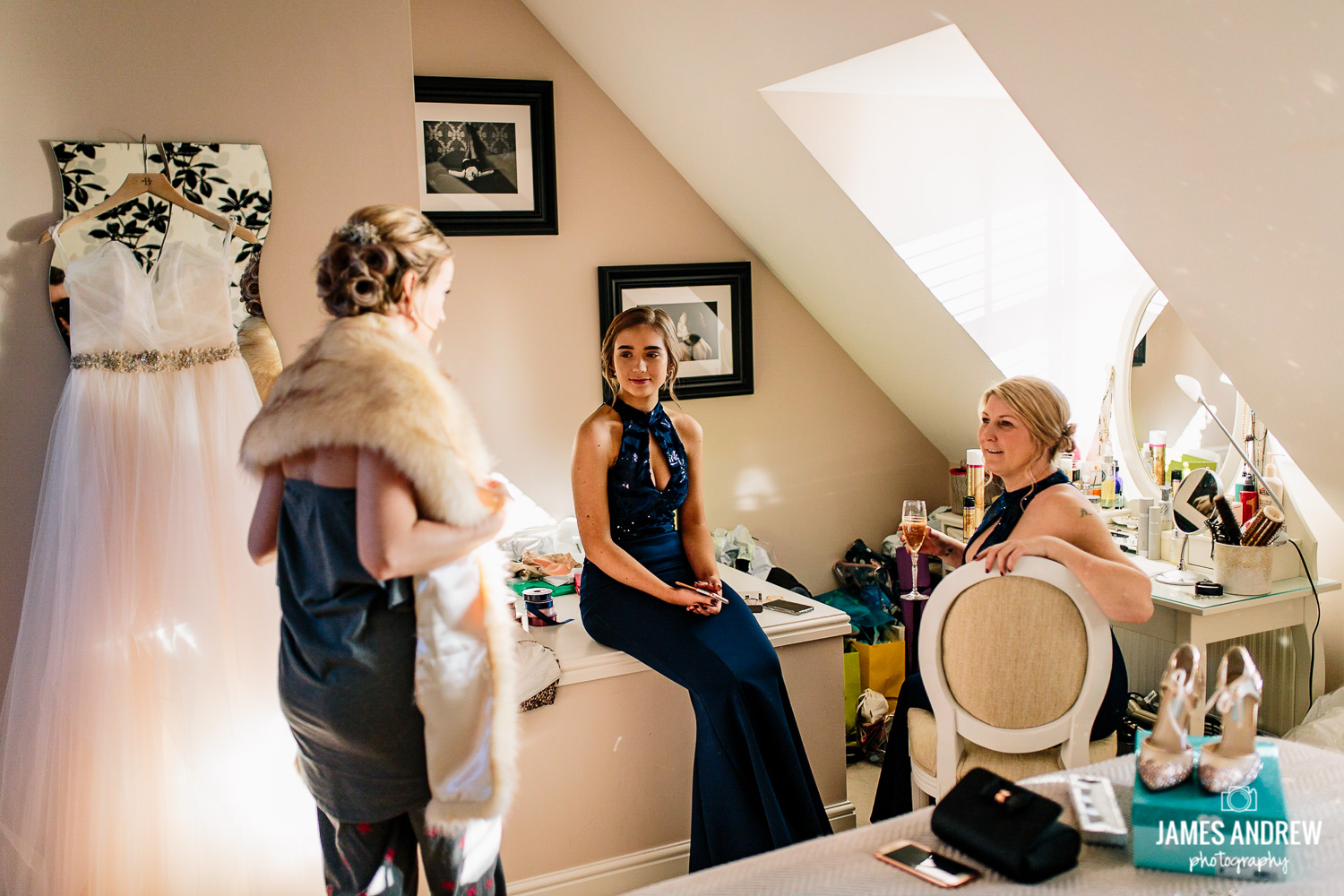 Bride and bridesmaids getting ready at home