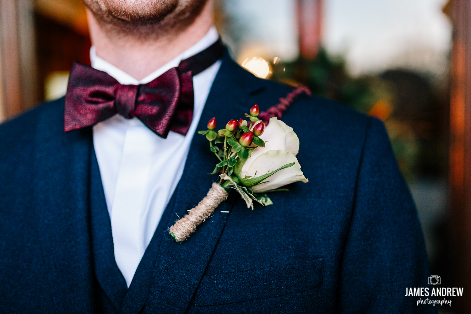 Grooms winter bow tie and button hole