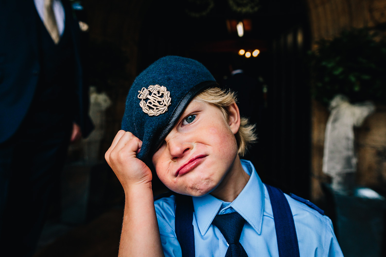 Kid pulling funny face at wedding