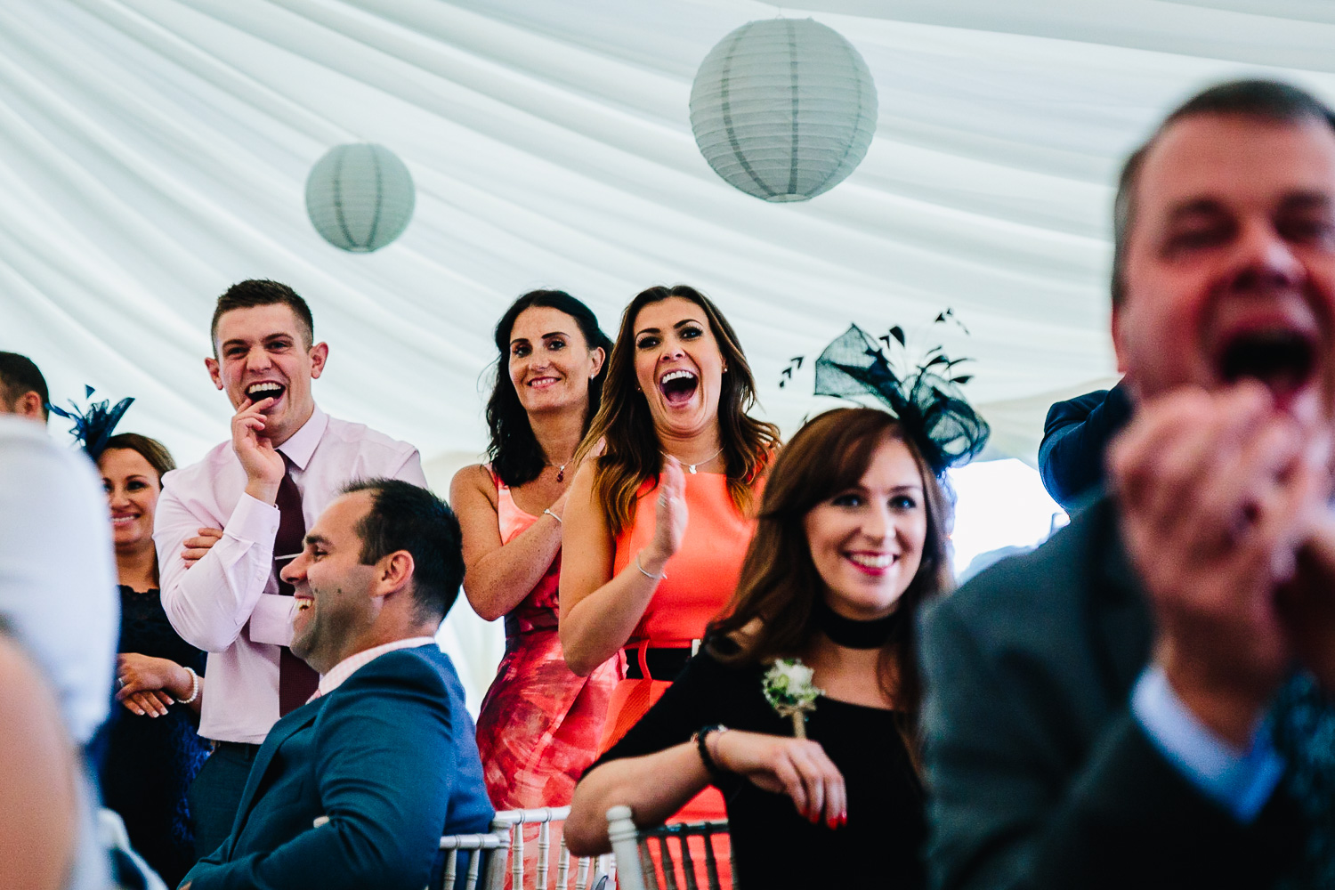 Wedding guests laughing at bestman speech candid natural