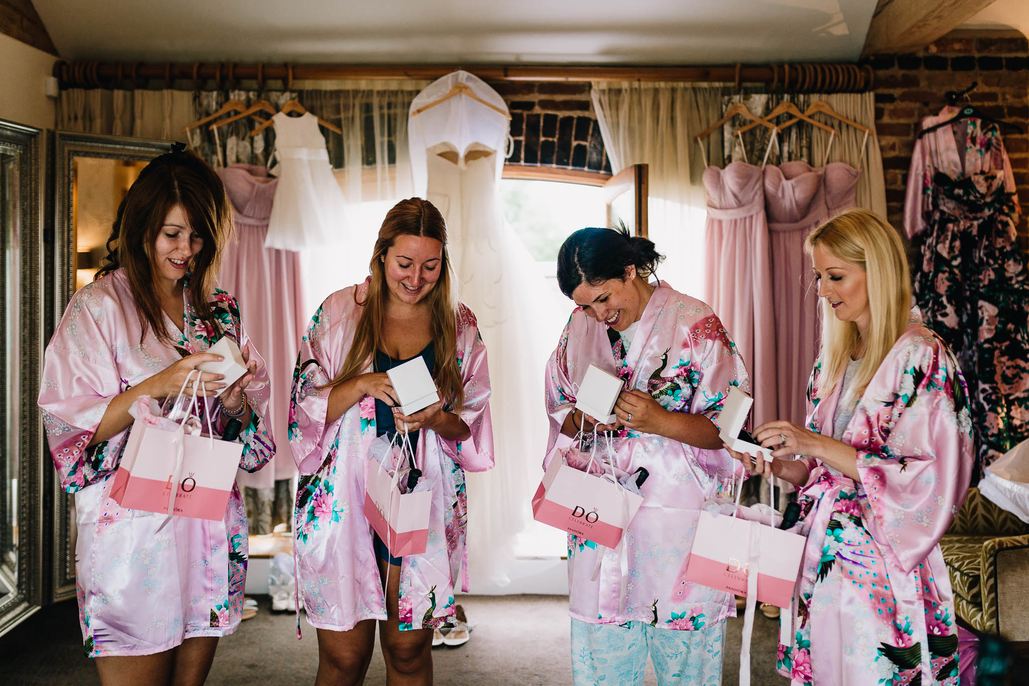 BRIDESMAIDS IN ROBES OPENING WEDDING GIFTS