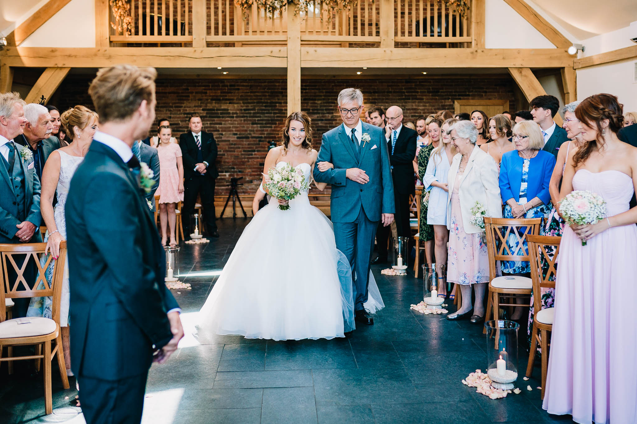 FATHER OF THE BRIDE WITH DAUGHTER WALKING DOWN THE ISLE
