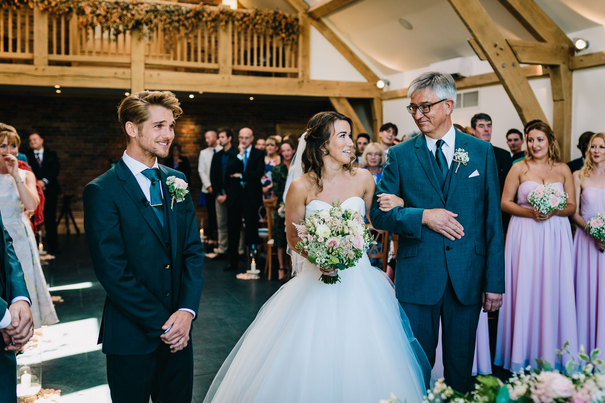 FATHER OF THE BRIDE LOOKING AT DAUGHTER BEFORE GIVING HER AWAY