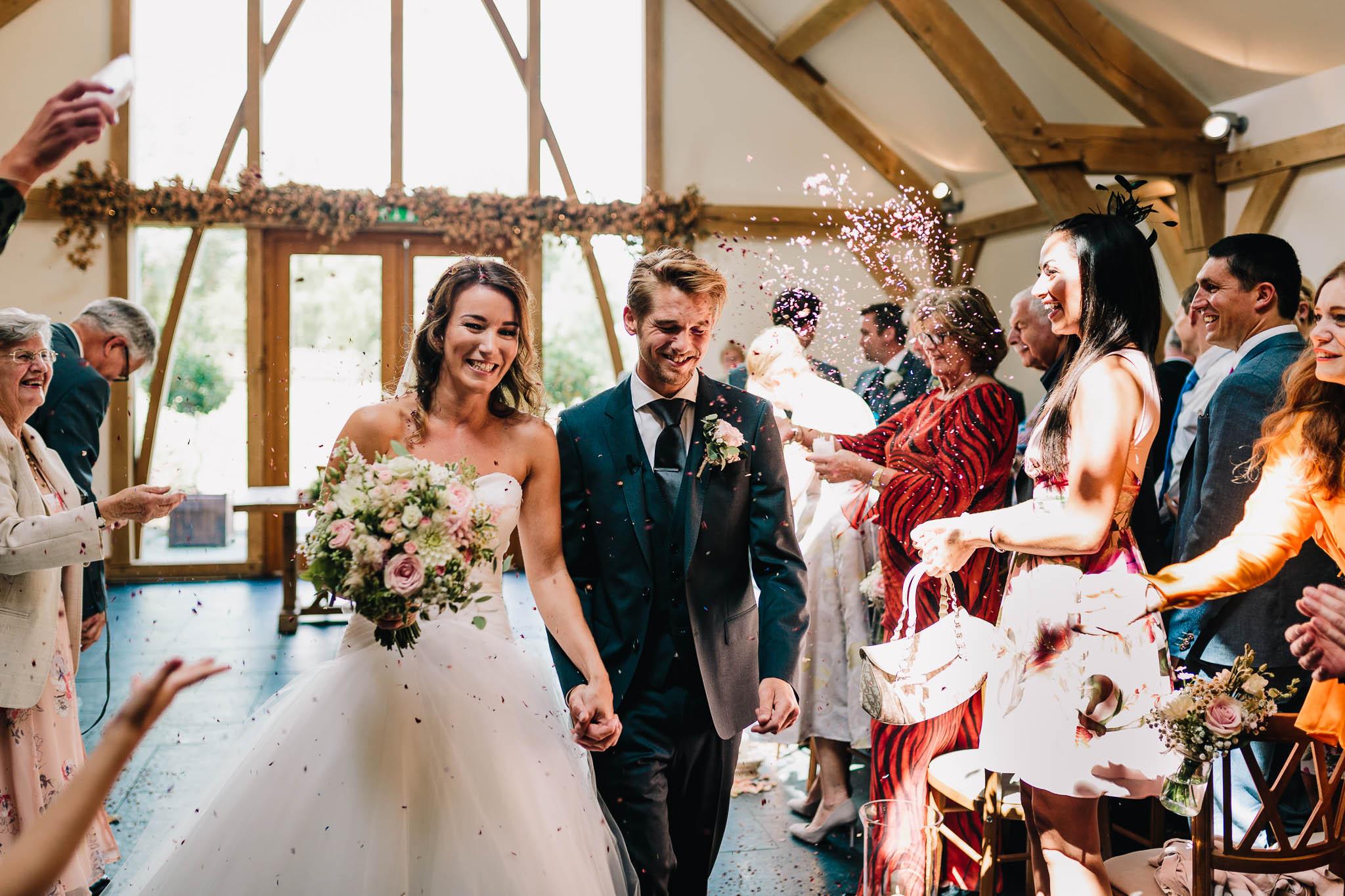 BRIDE AND GROOM CONFETTI WALK AFTER WEDDING