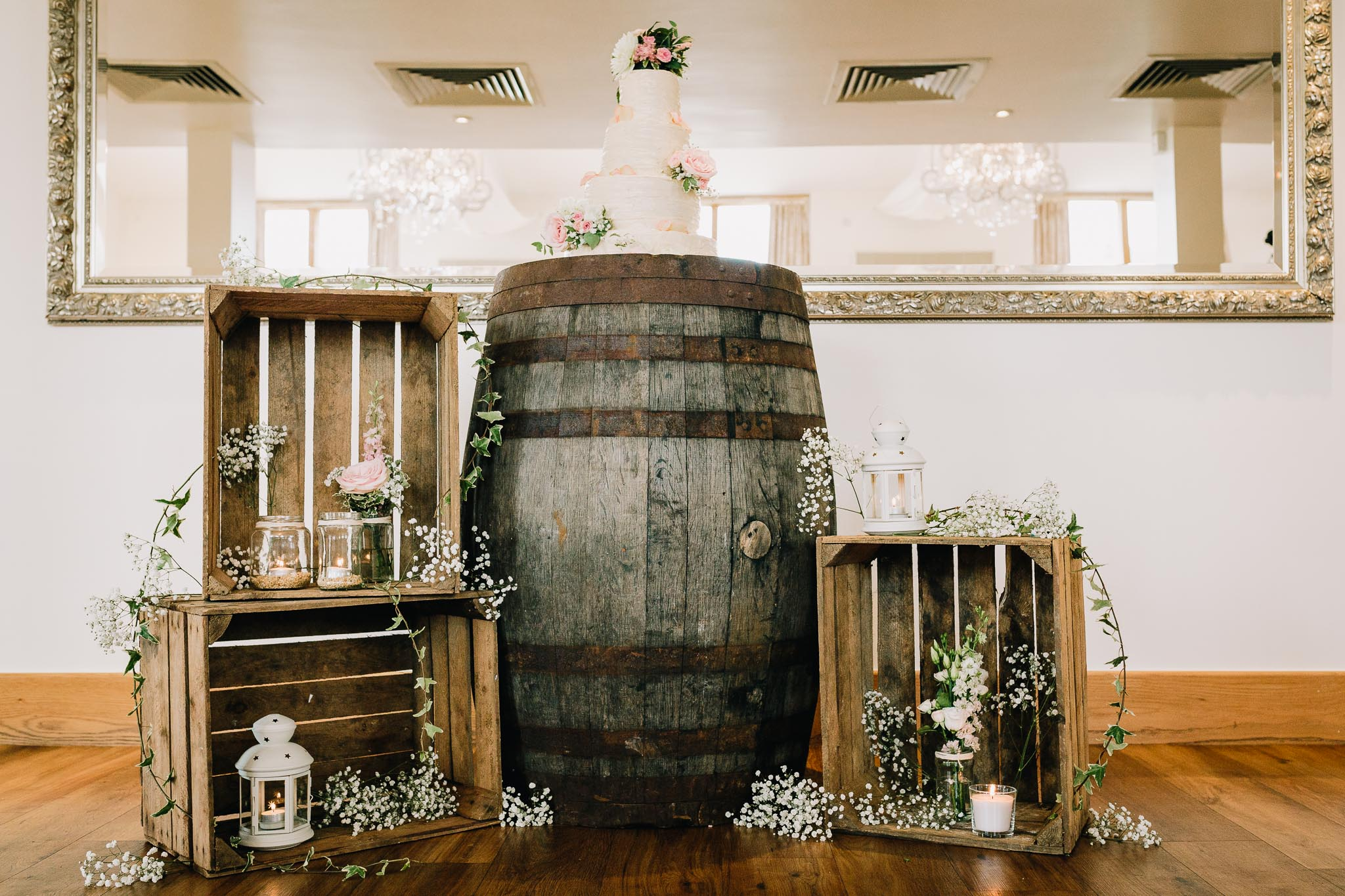 WHISKEY BARRELS AND RUSTIC CRATES AT WEDDING RECEPTION