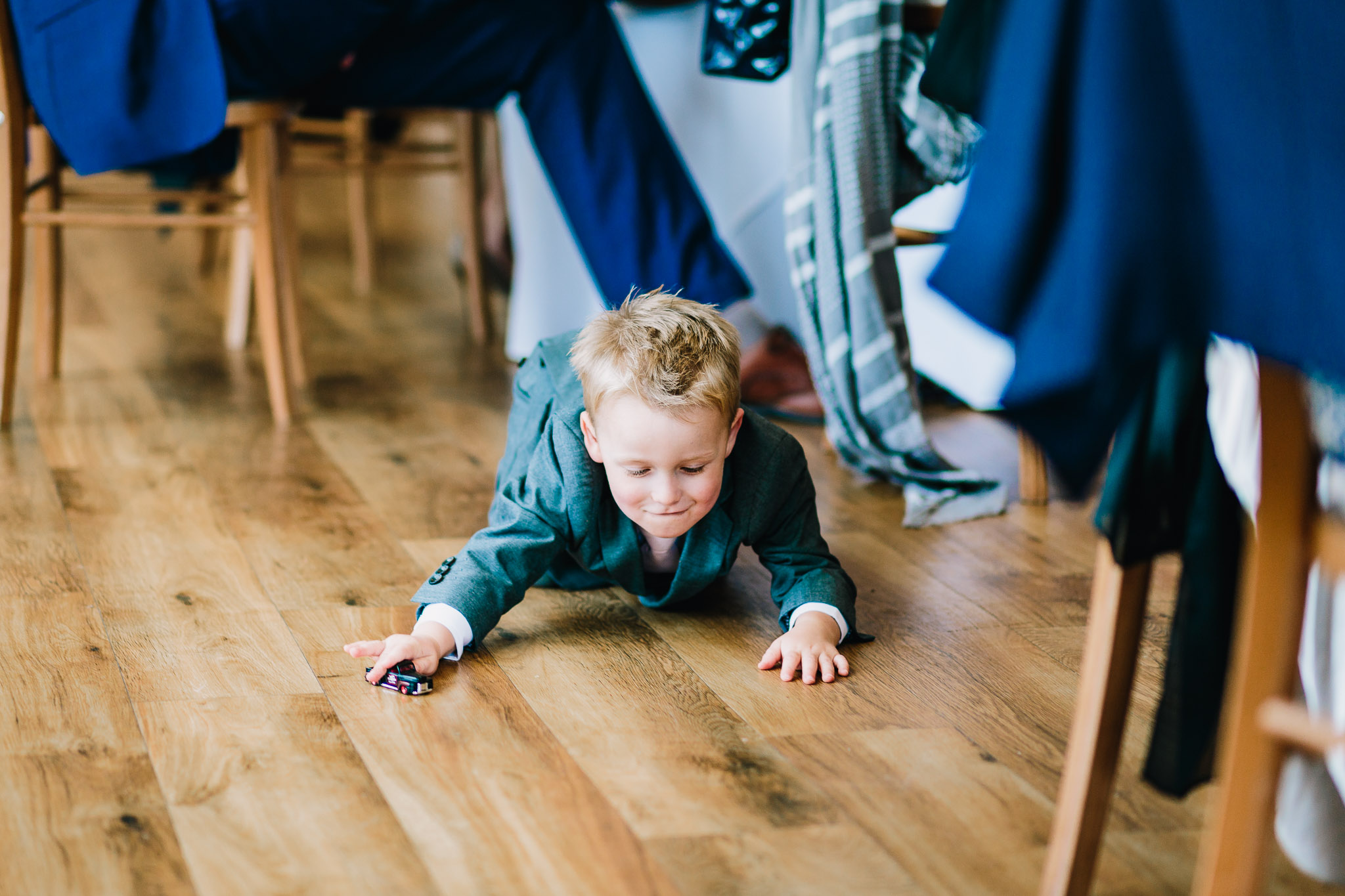 CHILD PLAYING AT WEDDING RECEPTION