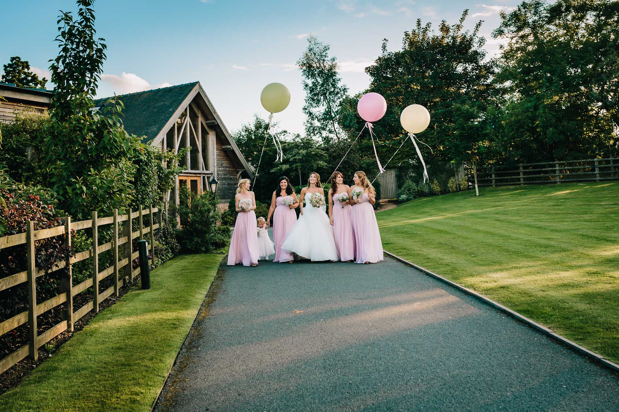 BRIDESMAIDS PORTRAITS WALKING WITH BALLOONS