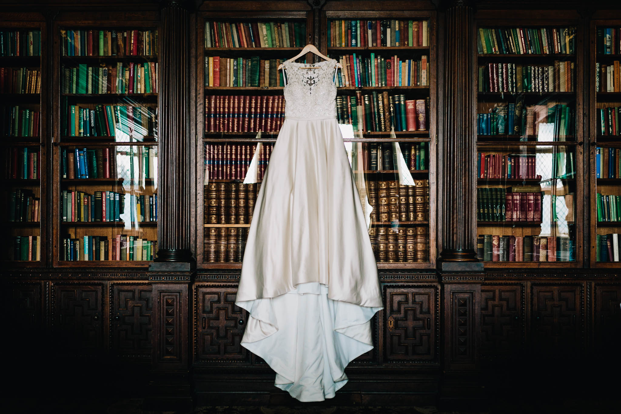 WEDDING DRESS HANGING IN THE GREAT LIBRARY AT HOGWARTS OR CREWE HALL