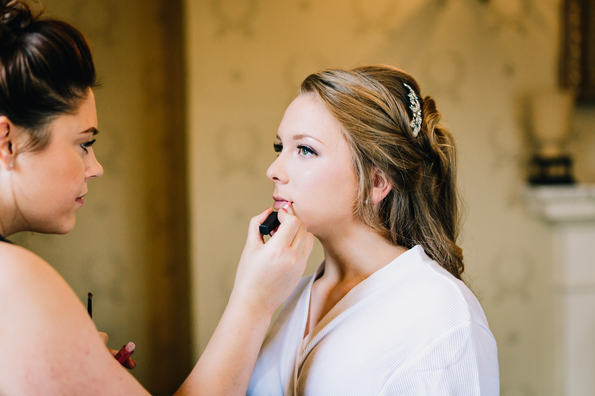 BRIDESMAID HAVING MAKEUP APPLIED BY MUA