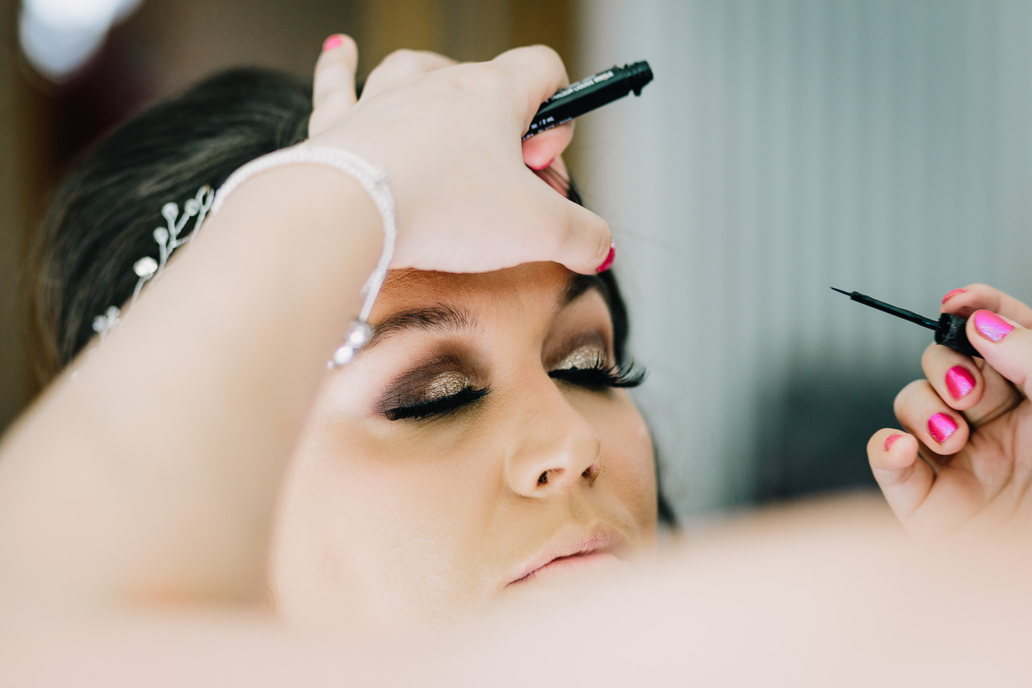 BRIDE WITH EYE MAKEUP GETTING READY IN THE MORNING