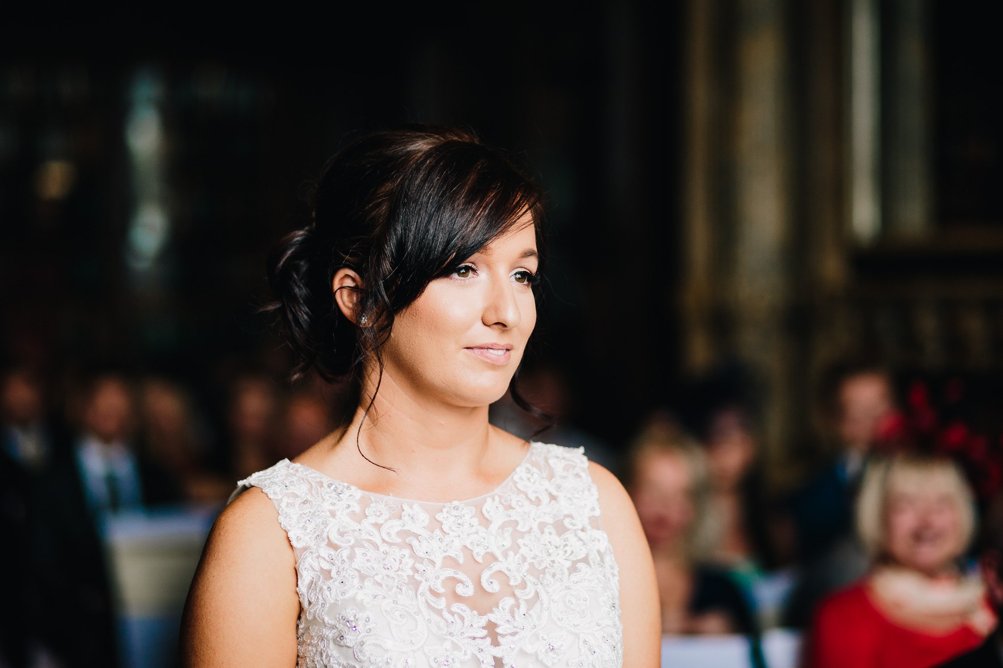 BEAUTIFUL BRIDE LISTENING TO VOWS AT CEREMONY