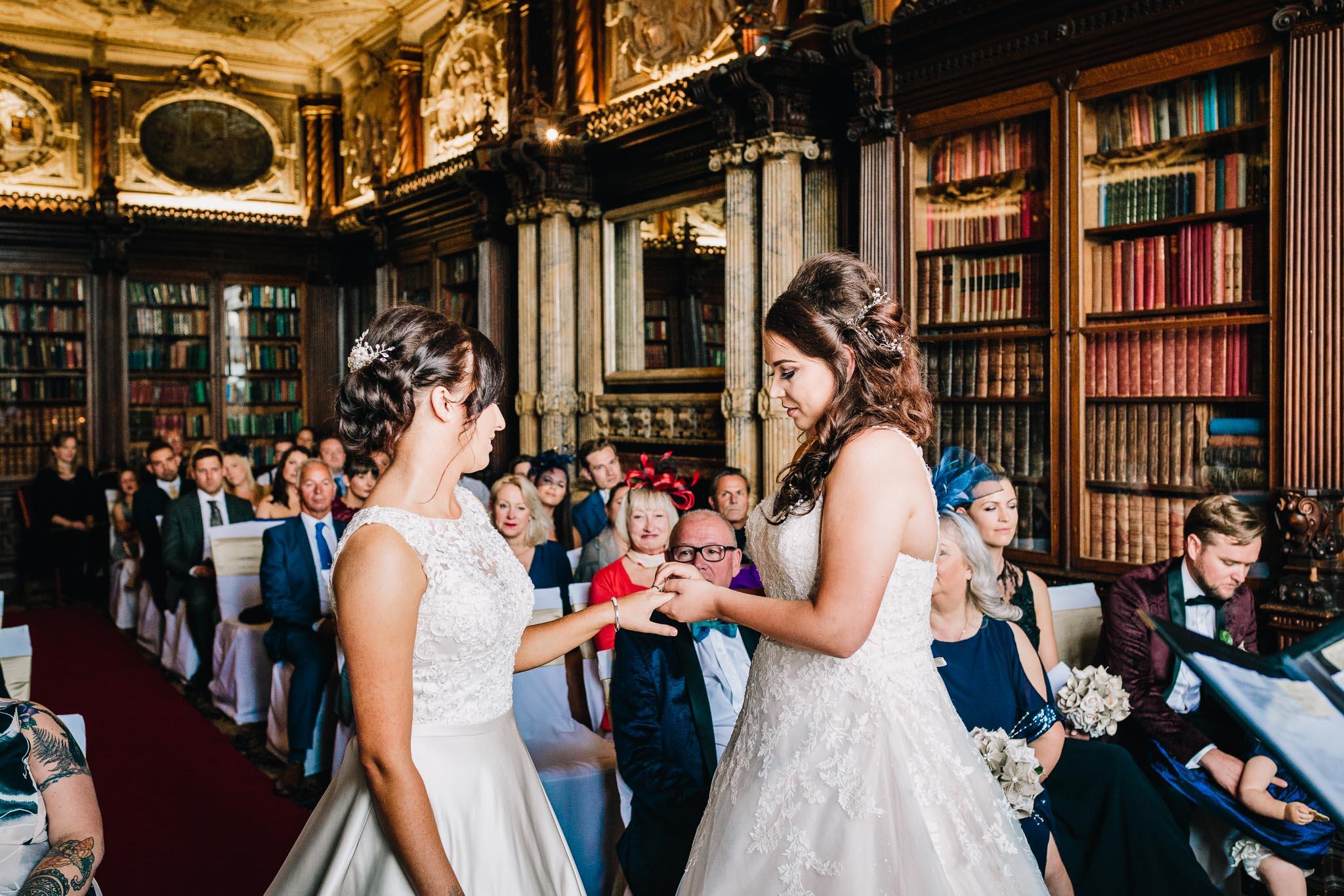 BRIDES EXCHANGING RINGS GAY WEDDING