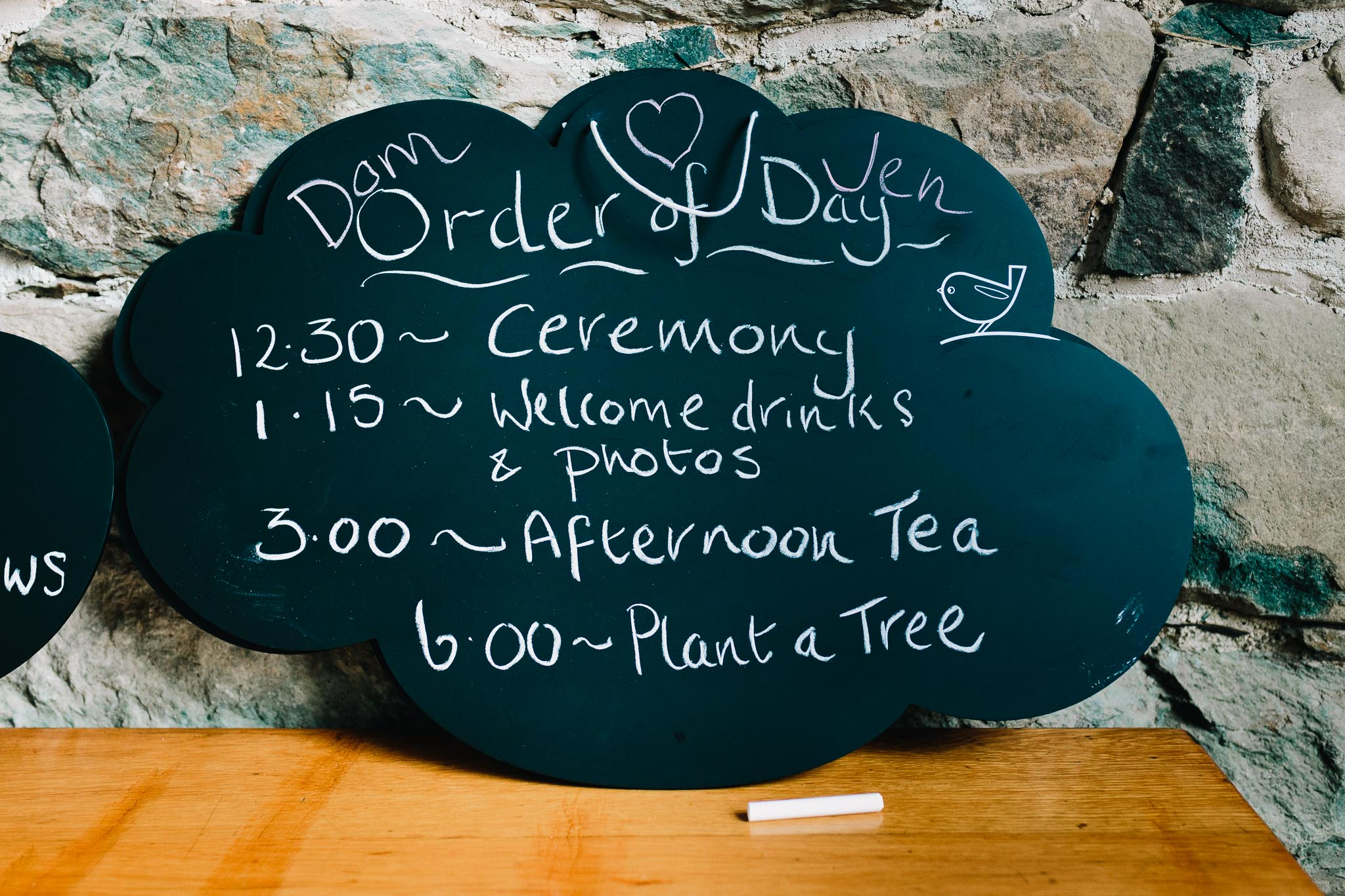 WEDDING CHALKBOARD SHOWING TIMINGS FOR THE BIG DAY