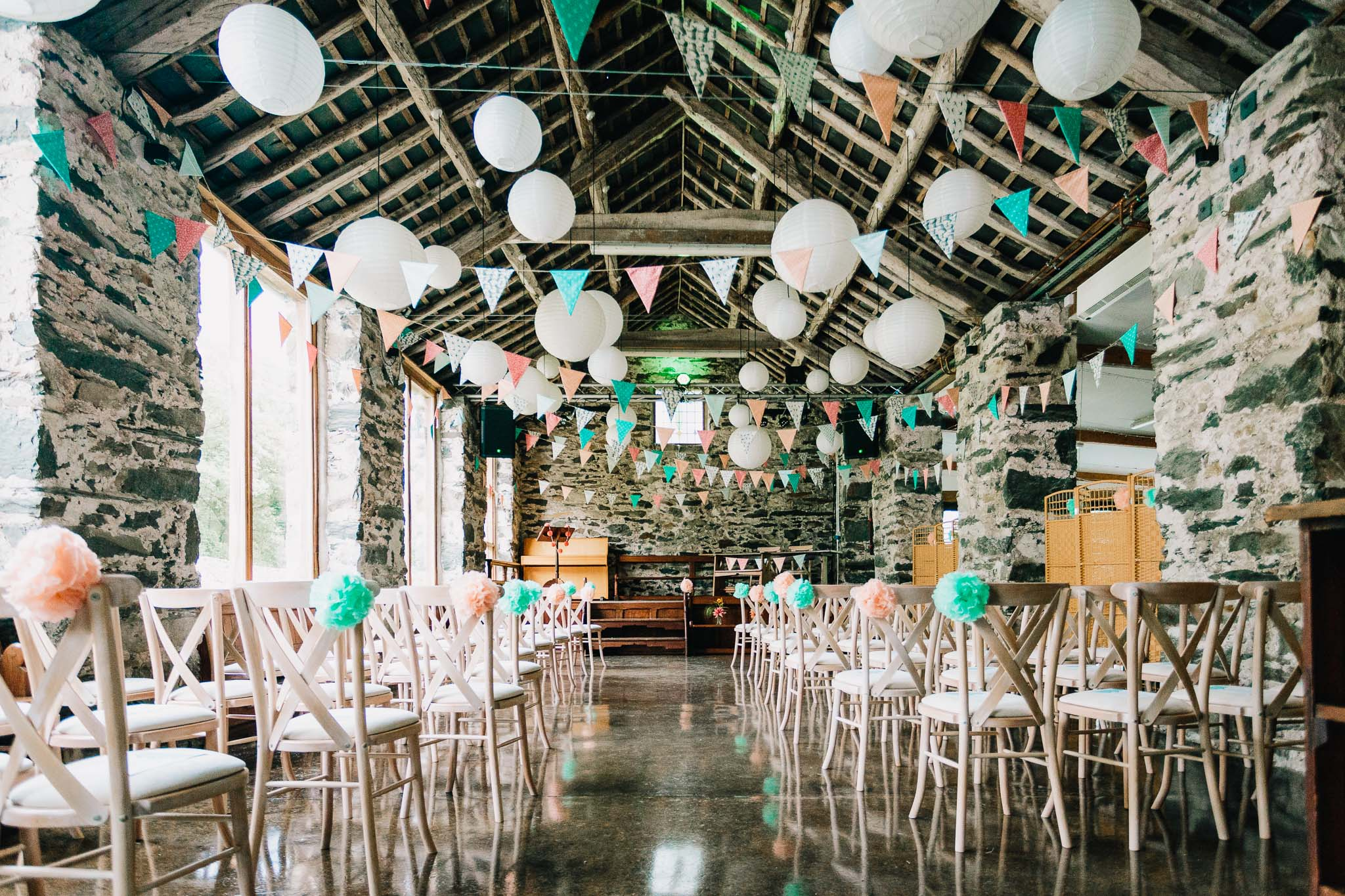 LLYN GWYNANT STONE BARN DECORATED IN PASTEL BLUE AND PINK FOR A WEDDING