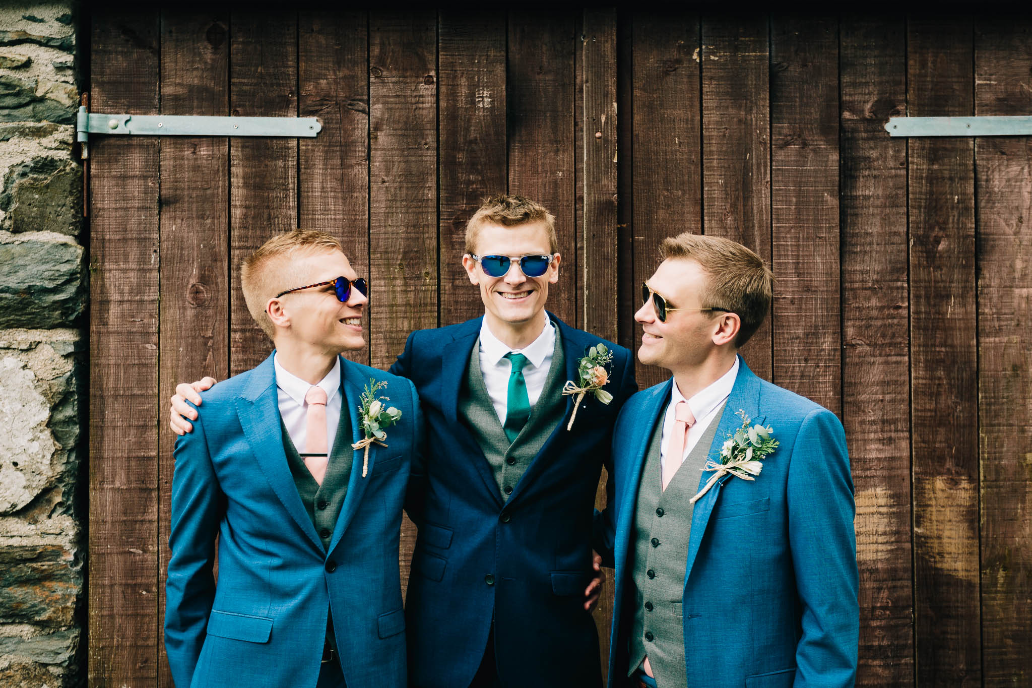 GROOM POSING WITH GROOMSMEN WEARING SUNGLASSES