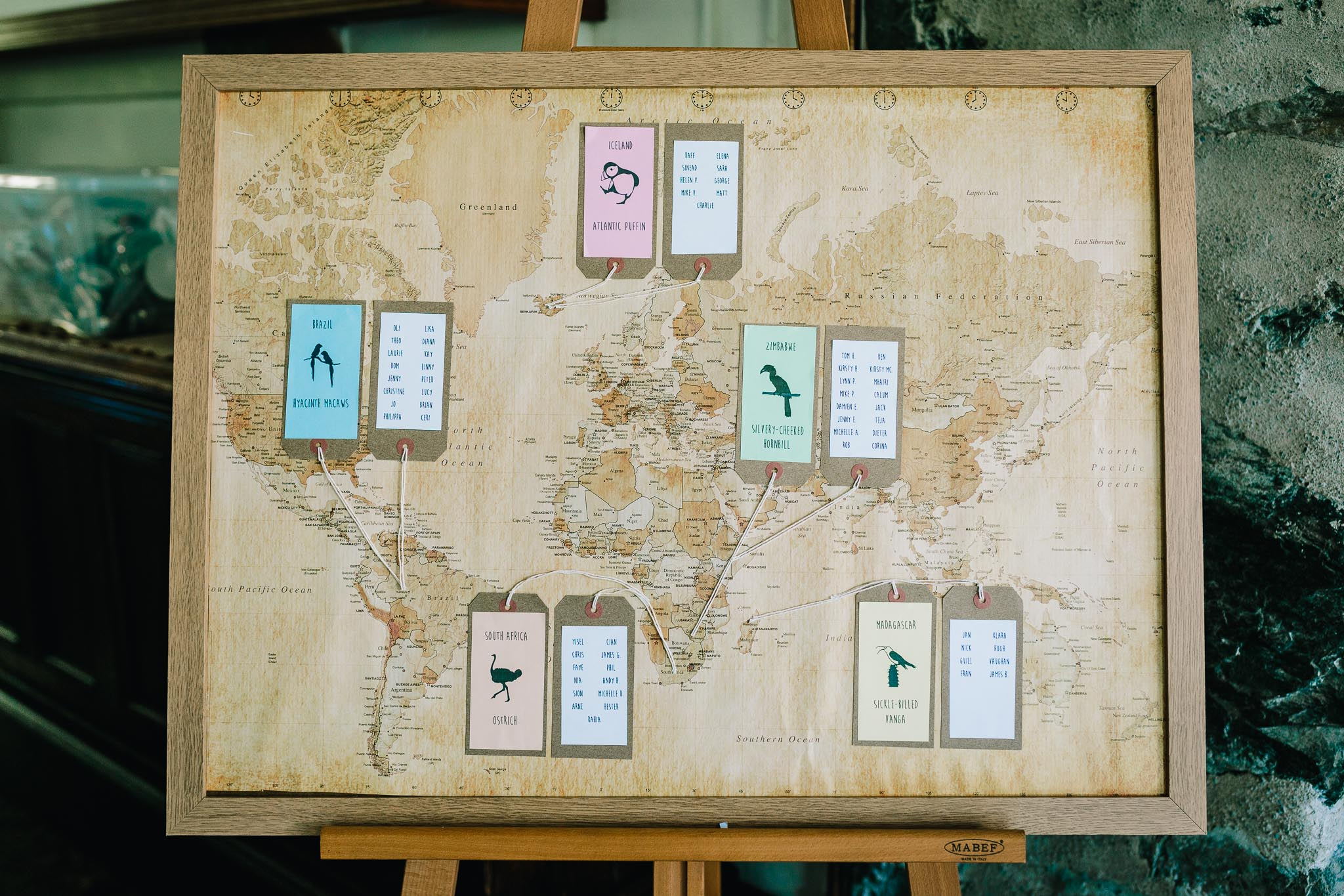 TABLE PLAN MADE FROM WORLD MAP WITH TRAVEL AND WILDLIFE THEME