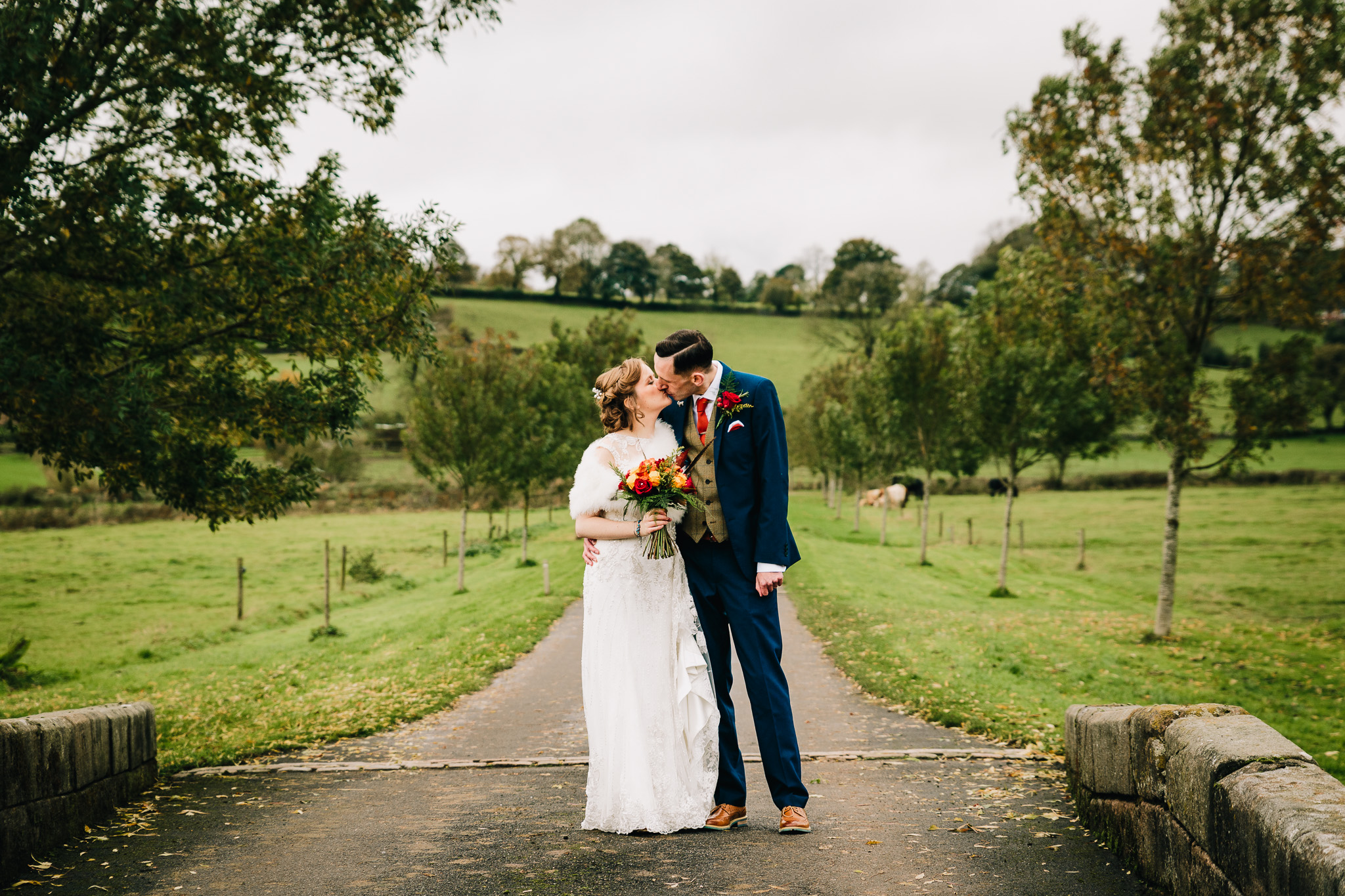 CREATIVE BRIDE AND GROOM PORTRAIT OUTDOORS