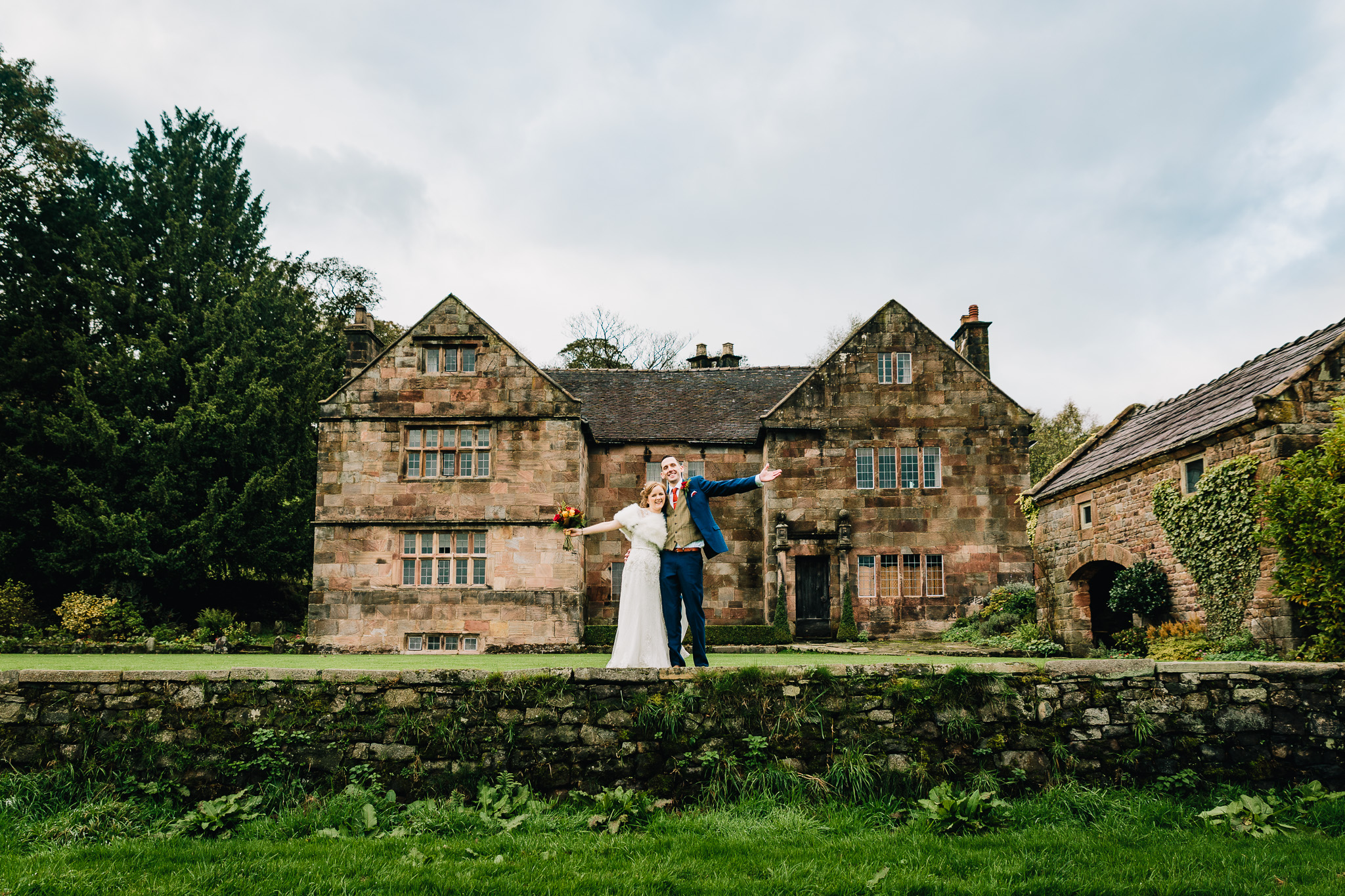 WEDDING COUPLE STOOD INFRONT OF COUNTRY HOUSE IN STAFFORDSHIRE