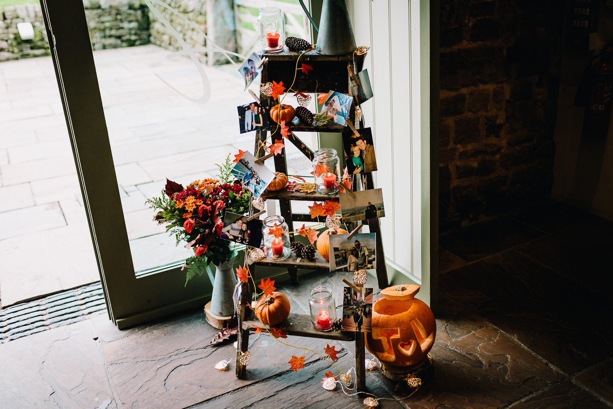 RUSTIC LADDERS WITH PHOTO FRAMES AT WEDDING