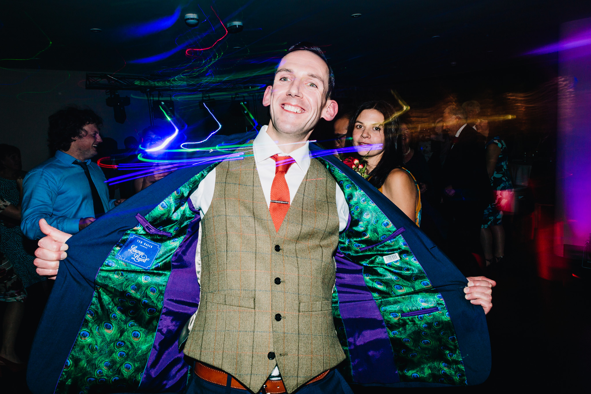 GROOM DANCING WITH LIGHTS AT WEDDING PARTY