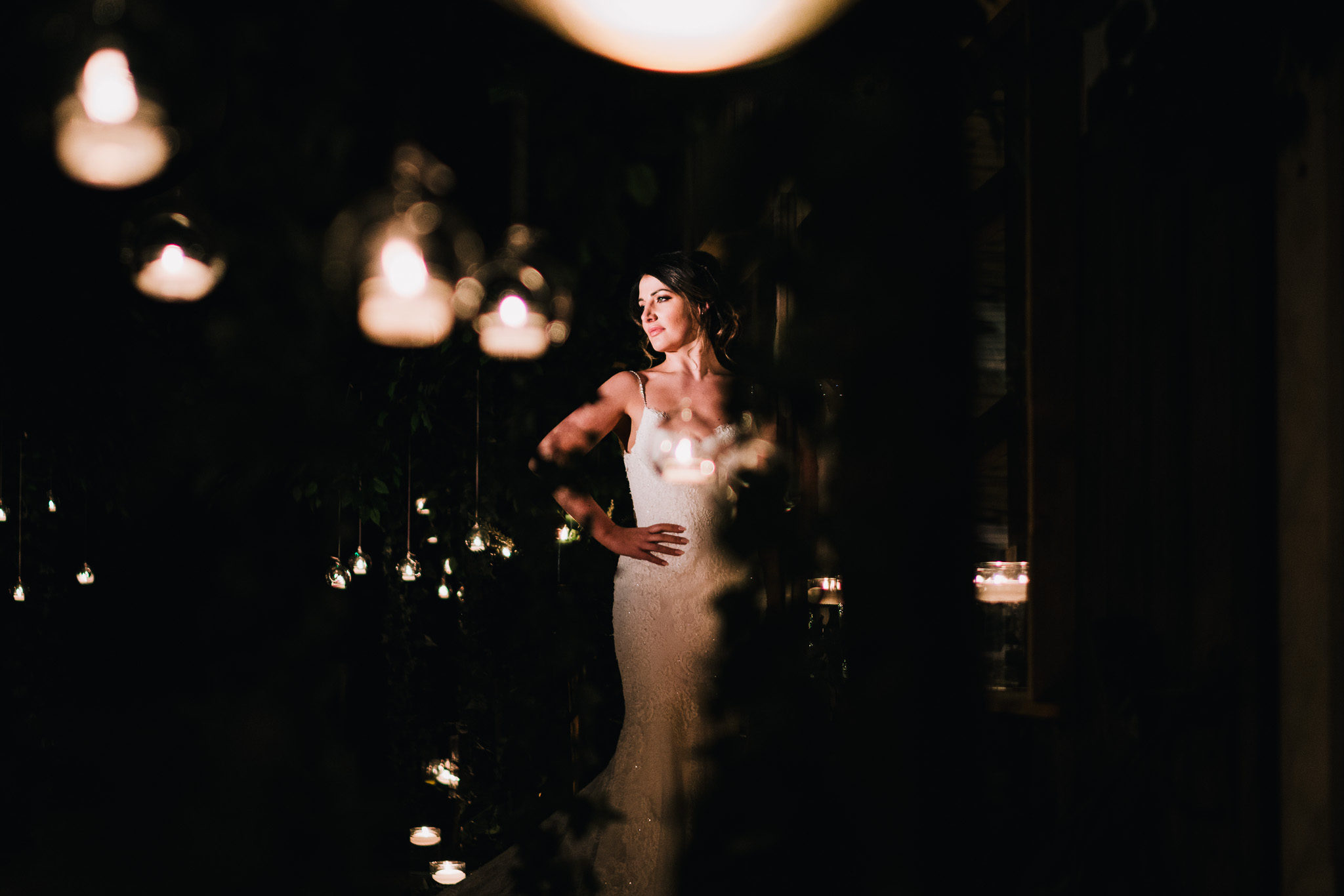 photo of stunning bride at night time with bokeh at owen house barn venue