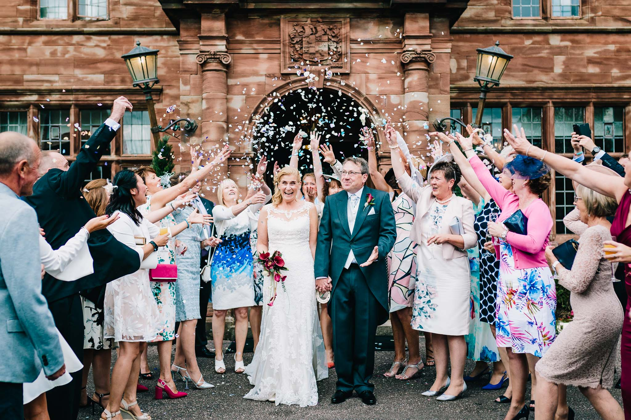 WRENBURY HALL WEDDING IN CHESHIRE CONFETTI SHOT