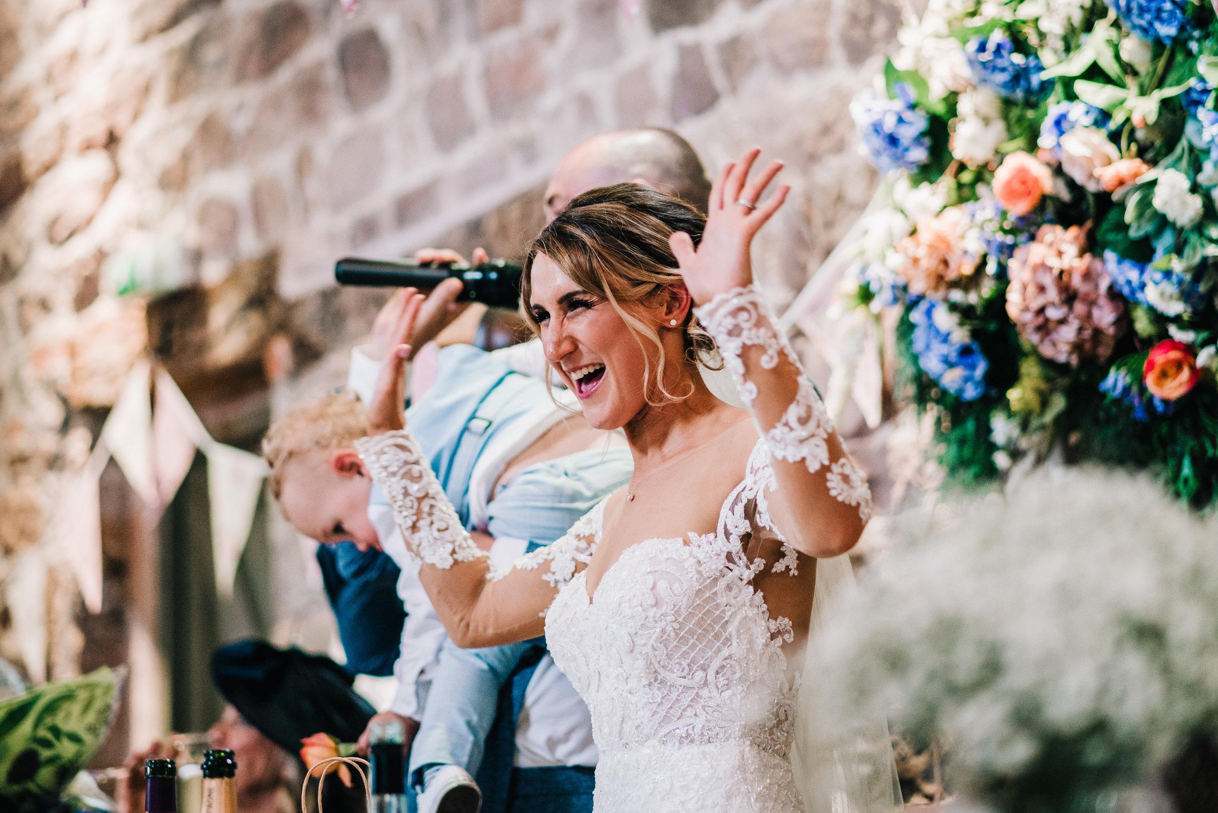 HAPPY BRIDE SMILING AT THE ASHES WEDDING BARN VENUE