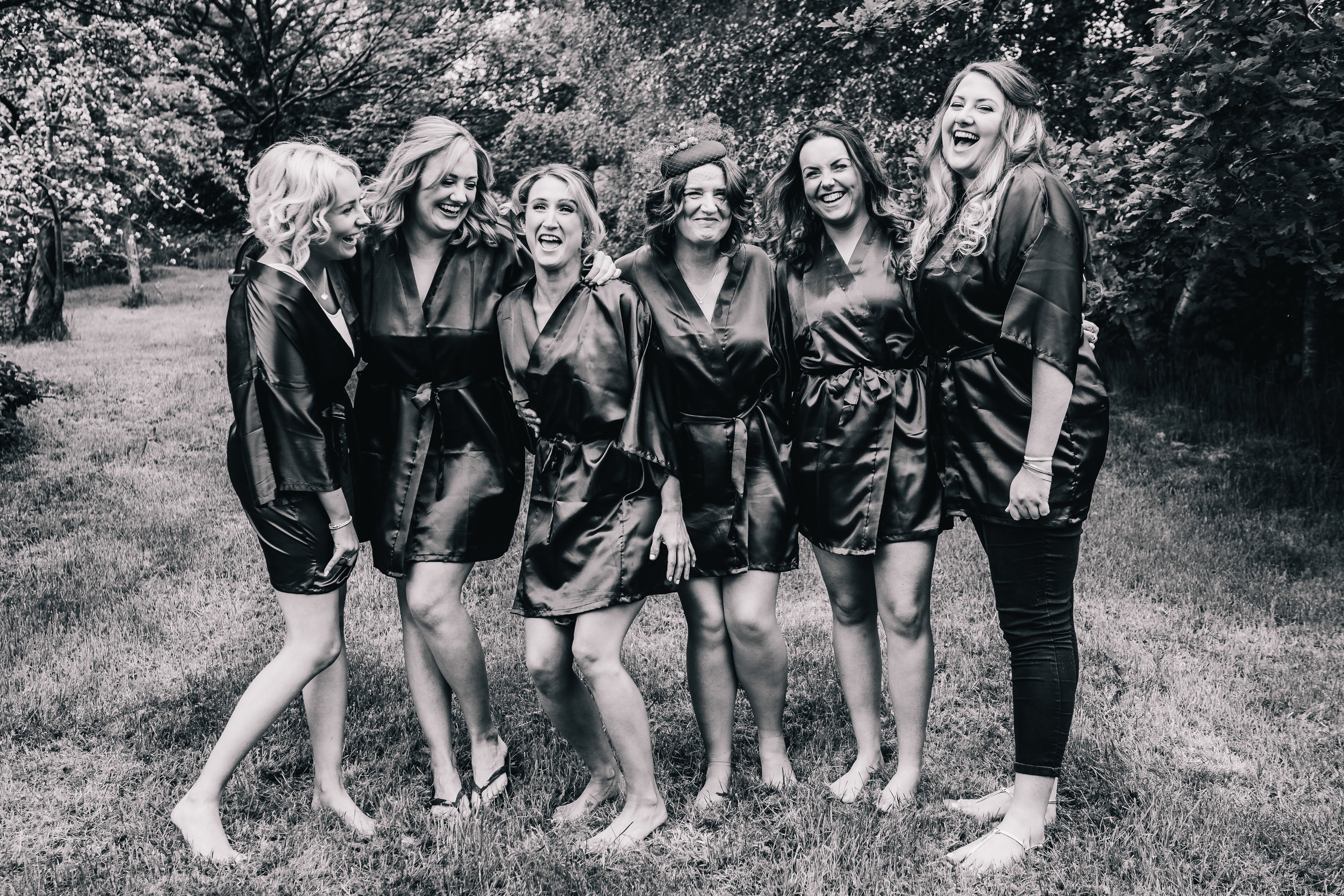 BRIDESMAIDS LAUGHING IN BLACK AND WHITE AT THE ASHES BARNS