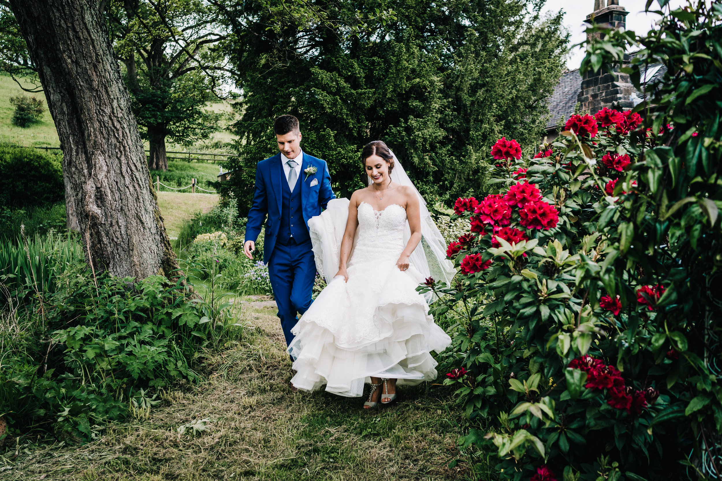 COUPLE WALKING THROUGH GROUNDS AT THE ASHES BARNS
