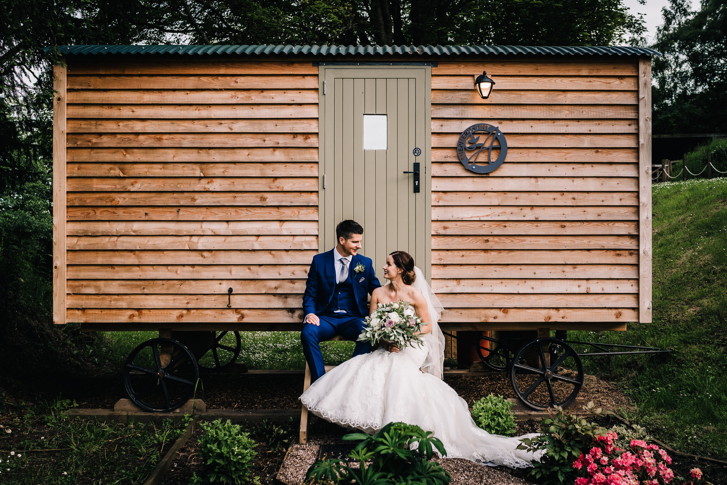 BRIDE AND GROOM AT THE SHEPARDS HUT IN THE ASHES BARNS VENUE STAFFORDSHIRE